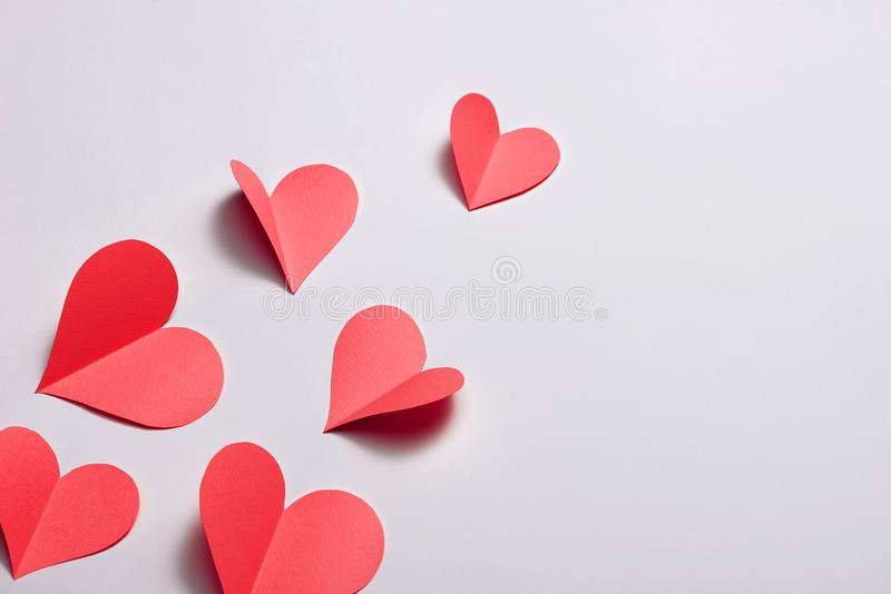 Fold paper Red hearts {Paper Heart cutting}, Heart of paper folding Isolated on White Background. Cards for Valentine`s Day There royalty free stock image