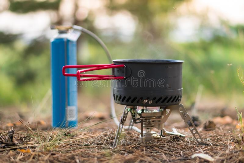Foldable camping gas fire system  with gas baloon and  a pot with radiator for fast heating royalty free stock photography