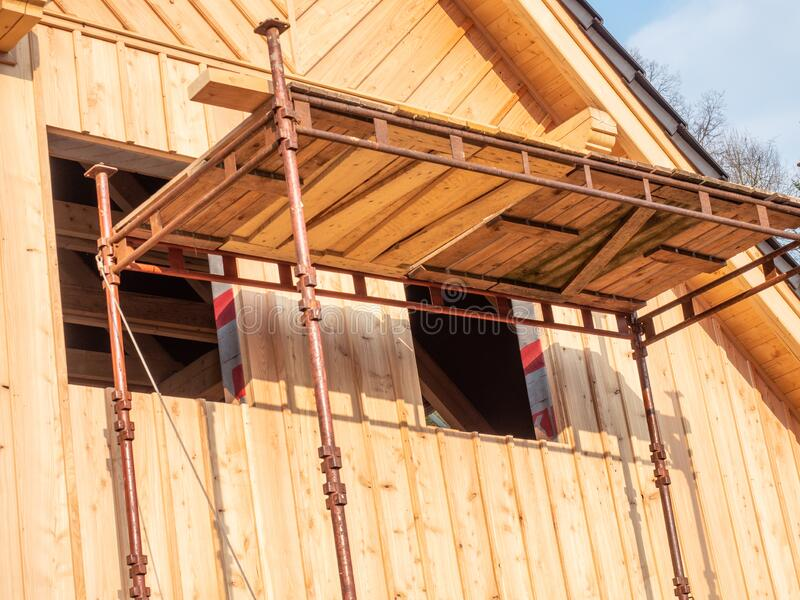 Foldable scaffolding at new wooden country house stock photography