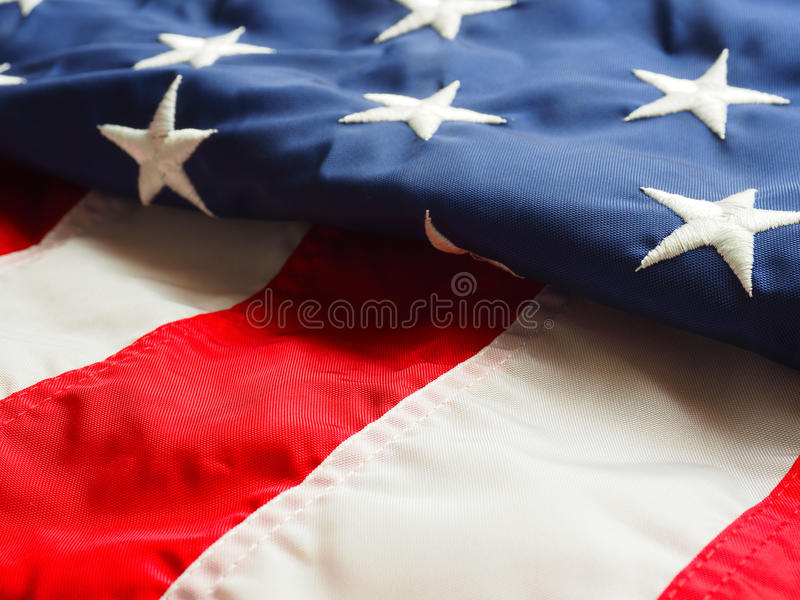 Folded American flag. Detail of a partial folded American flag using as background royalty free stock images
