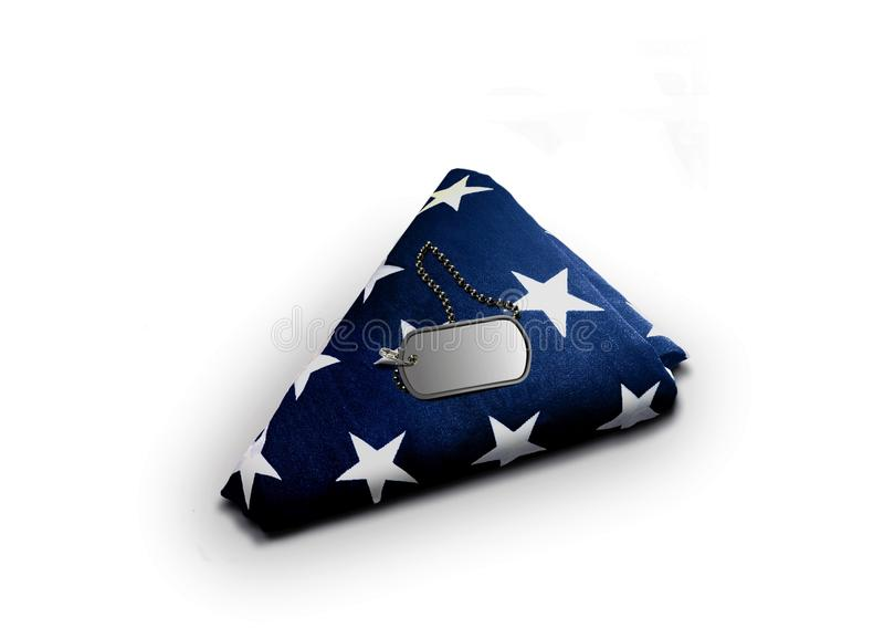 Folded American Flag with Military Dog-tag. On white royalty free stock images