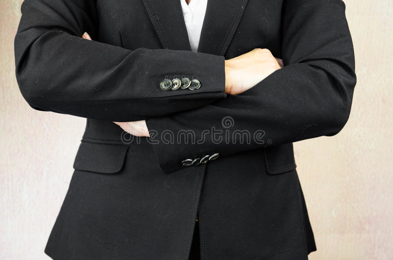 Folded arms. Business concept with folded arms royalty free stock photo