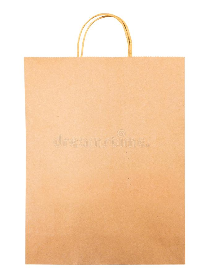 Folded brown paper bag isolated on white background. Shopping bag made from cardboard material. royalty free stock image