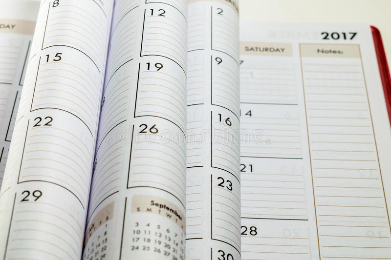 Folded calendar pages in focus with blurred 2017 in the background stock photos