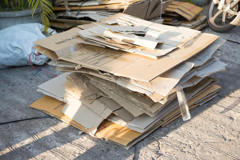 Folded Cardboard Used Boxes. Stack of Folded Cardboard Used Boxes stock image