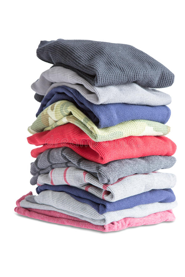Folded Clean Clothes in a Pile on White Background. Close up Folded Assorted Clean Clothes in One Pile Isolated on White Background royalty free stock photo