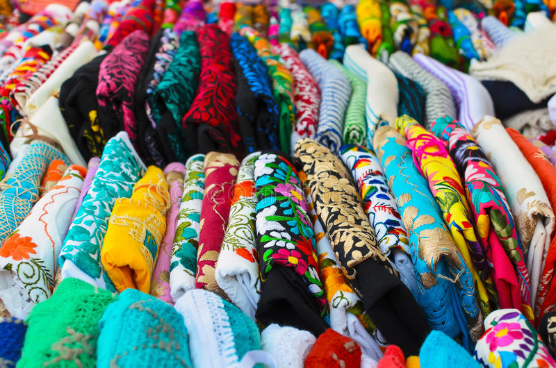 Folded colorful authentic Mexican women's shirts for sale at the stock image