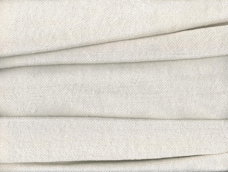Folded cotton fabric. An old towel of cotton fabric stock photos