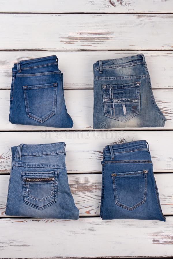 Folded denim pants, flat lay. Pockets of jeans. Promo shot for new street style collection stock image