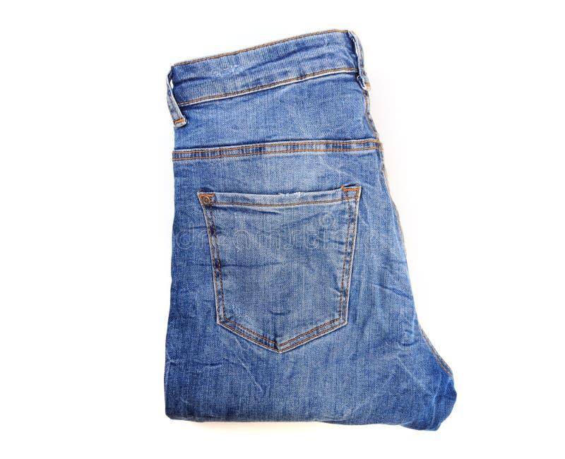 Folded jeans isolated on white background. - Image. Folded jeans isolated on white background royalty free stock photo