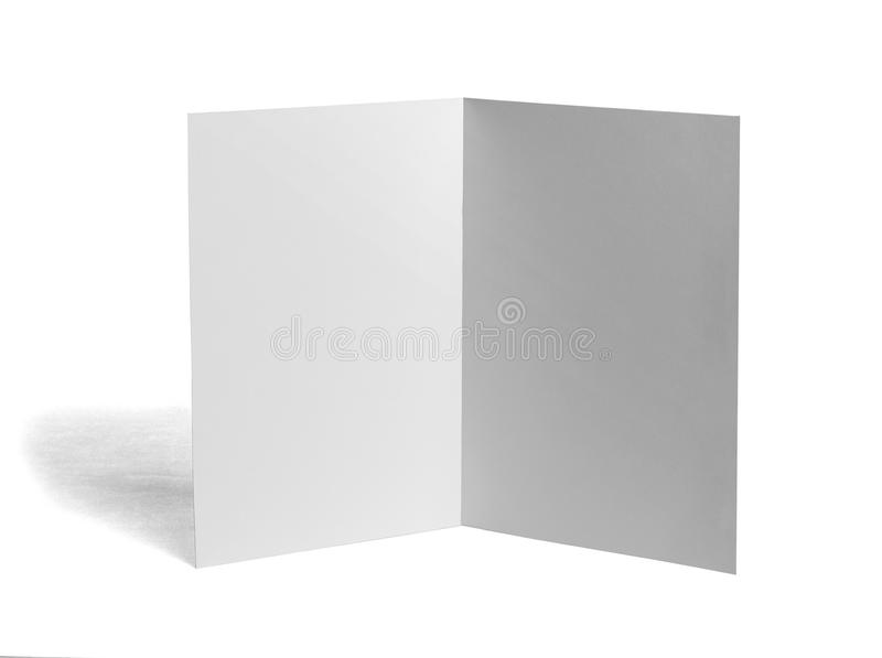 Folded leaflet white blank paper template book. Close up of a blank folded leaflet white paper on white background royalty free stock image
