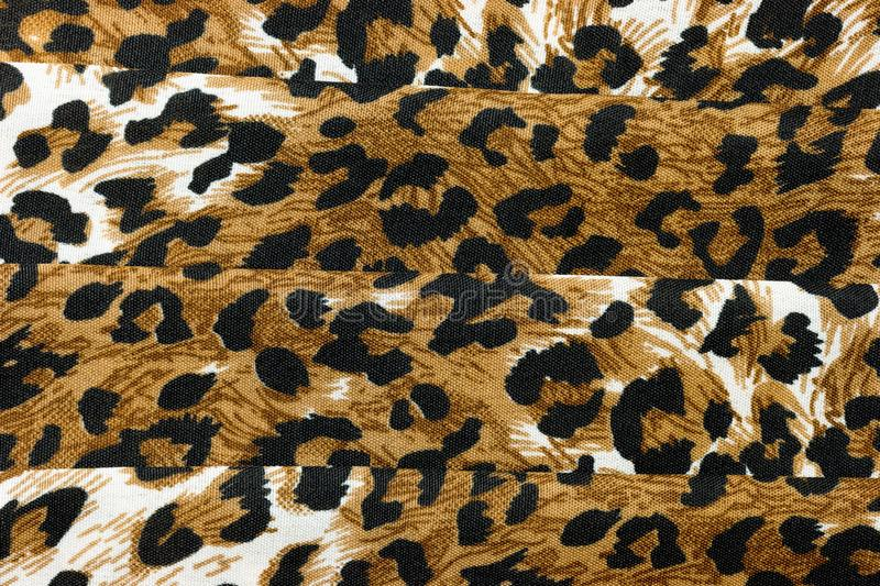 Abstract textured background of folded animal print fabric stock photography