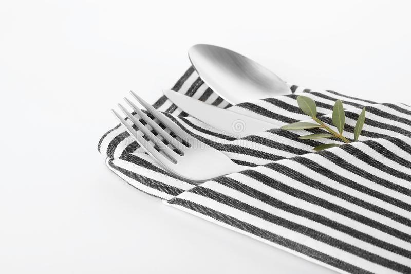 Folded napkin with fork, spoon and knife stock images