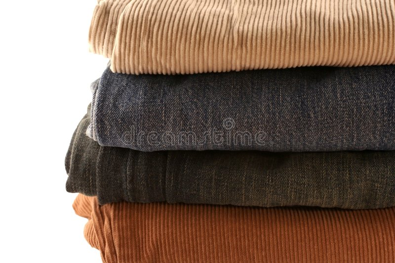 Folded pants in a stack stock image