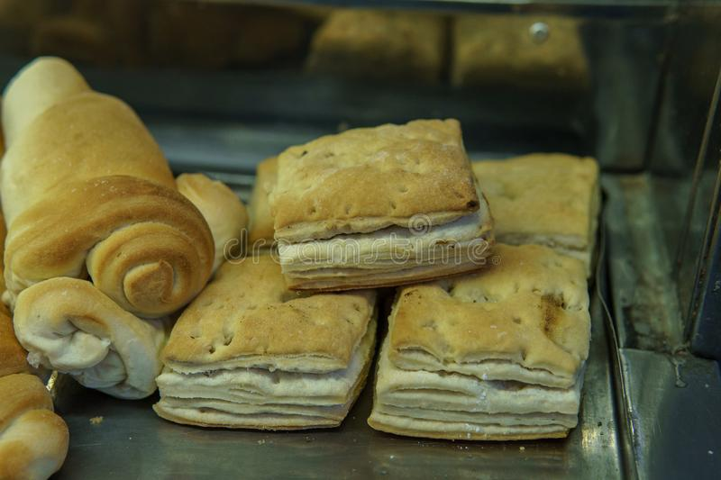 Folded pastries being sold in store. Freshly made pastries being sold in a bakery in Buenos Aires, Argentina, food, argentine, argentinian, background, breakfast stock images