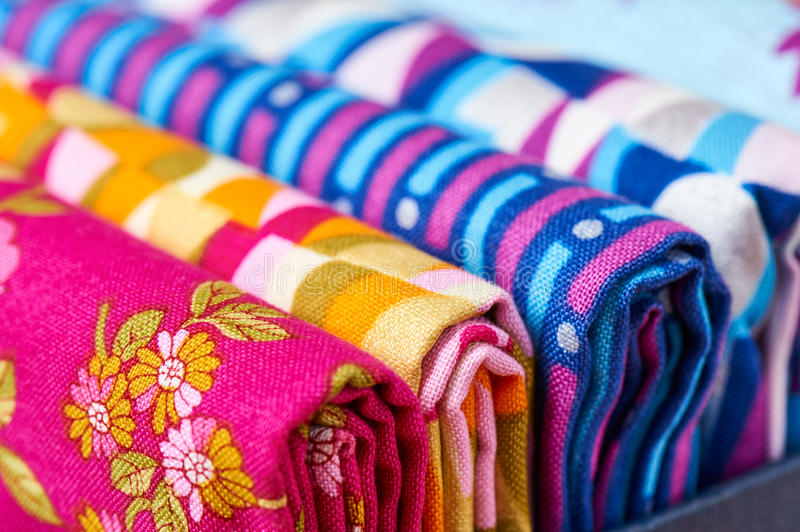 Folded pieces of quilting fabrics lying in a box, macro royalty free stock photos