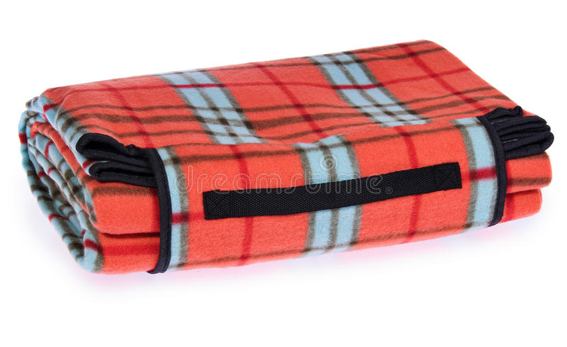 Folded up travel, picnic blanket grille with red, blue, black. royalty free stock photos
