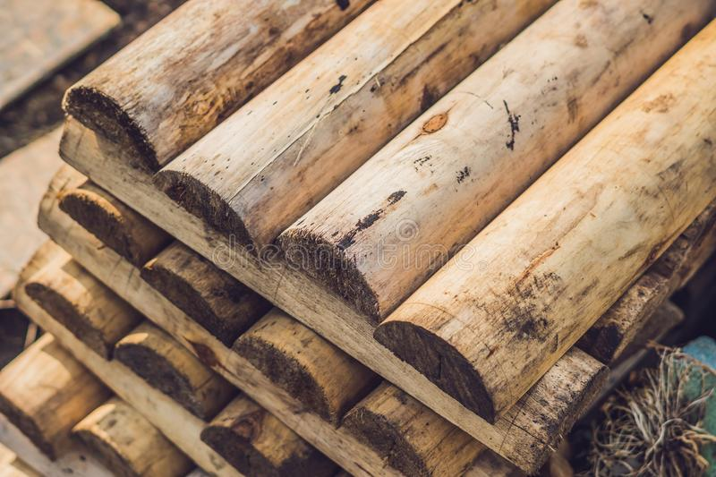Folded in wooden piled beige beech boards, uneven bars background in a sawmill. Sawn-off boards.  stock photography