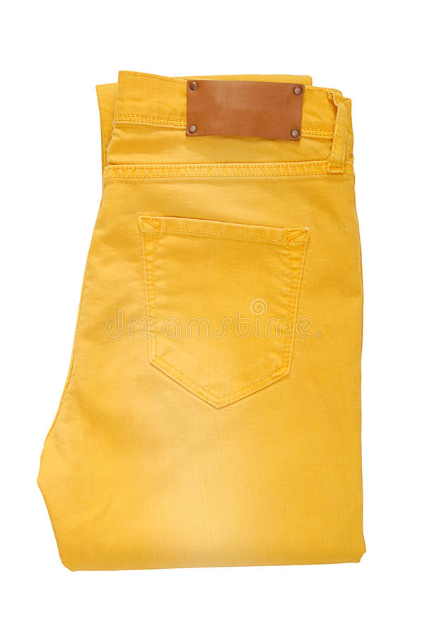 Folded yellow jeans royalty free stock image