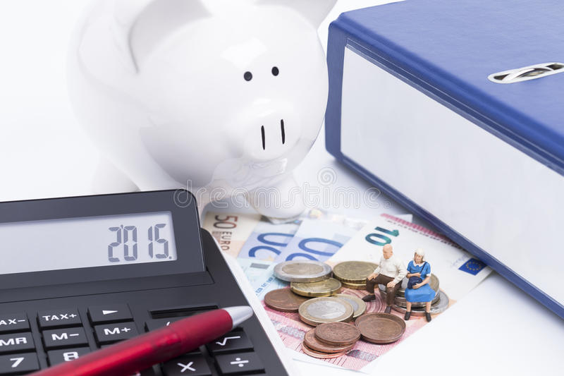 Folder with calculator and money. Blue folder with money, calculator and pen stock images
