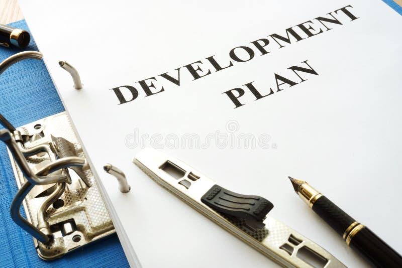 Folder with development plan. stock images