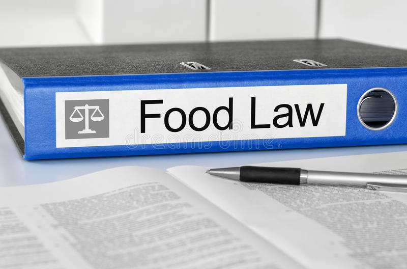 Folder with the label Food Law. Blue folder with the label Food Law stock photo