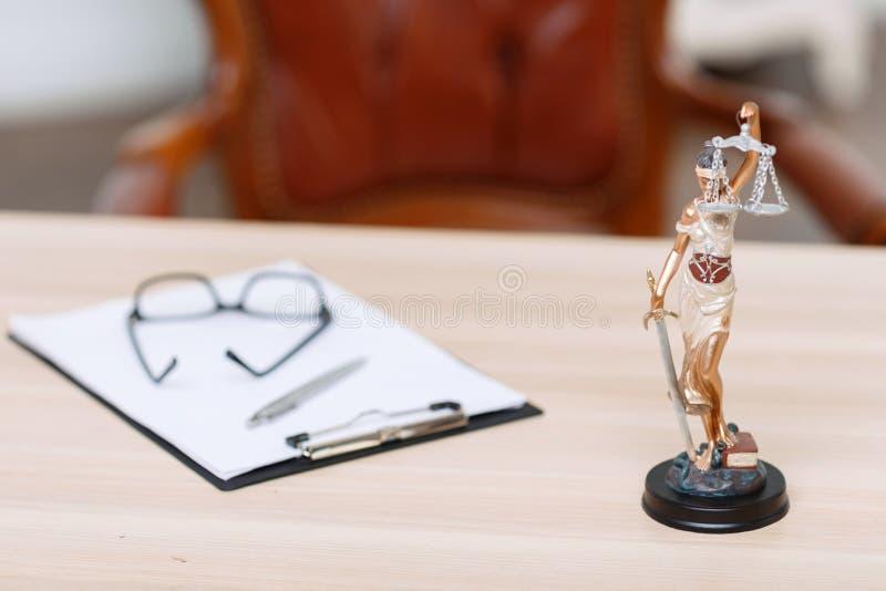 Folder lying on the table. Ready to work. Folder lying on the table near little statue of justice stock image