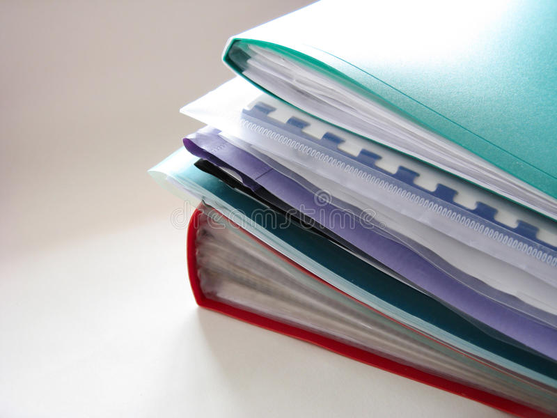 Folders. Stack of plastic folders on the table stock photo