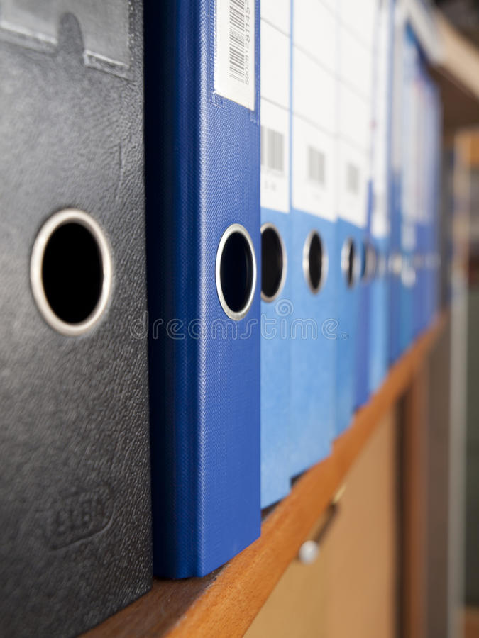 Folders. On the rack in office stock photography