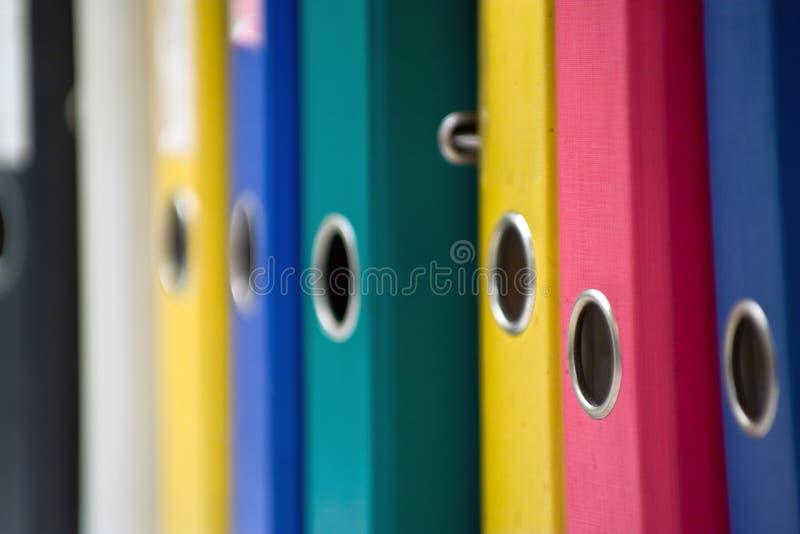Folders. Office folders at the bookshelf royalty free stock images