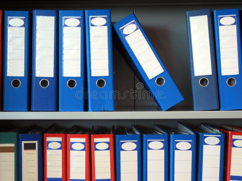 Folders. Some folders in a shelf royalty free stock photo