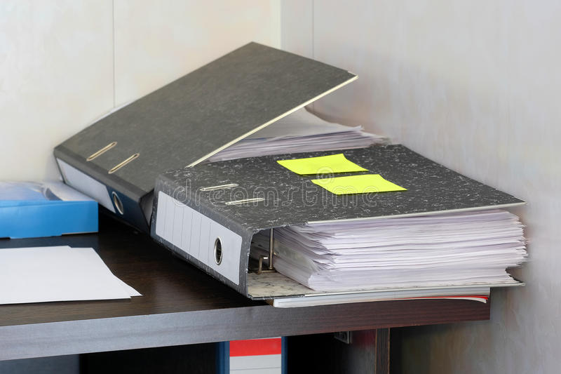 Folders with documents. On an office table royalty free stock images