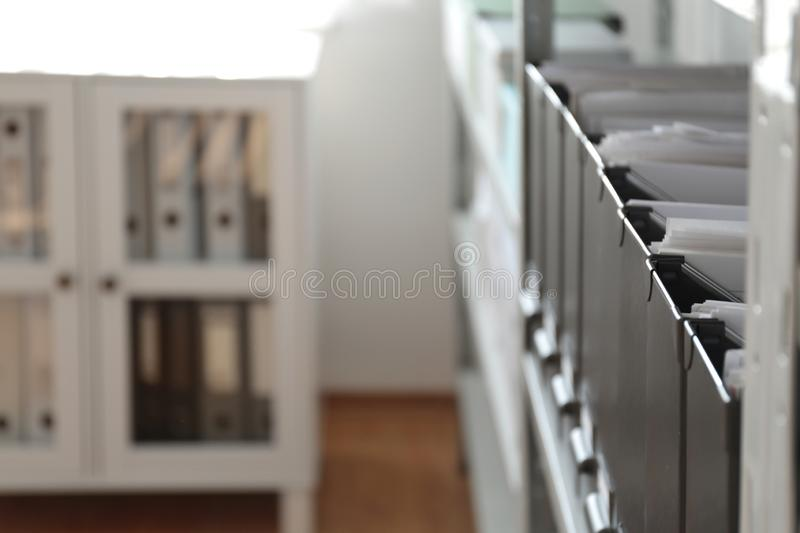 Folders with documents on shelf in archive. Space for text royalty free stock images
