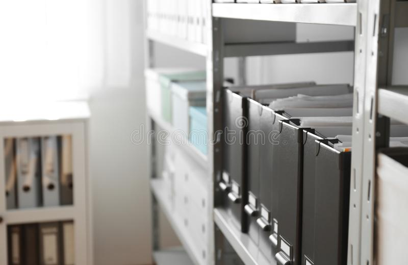 Folders with documents on shelf in archive. Space for text royalty free stock photos