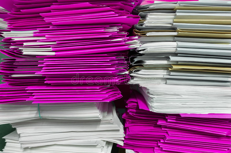 Folders and documents stacked. Stacks of purple folders and socuments in archive stock photo