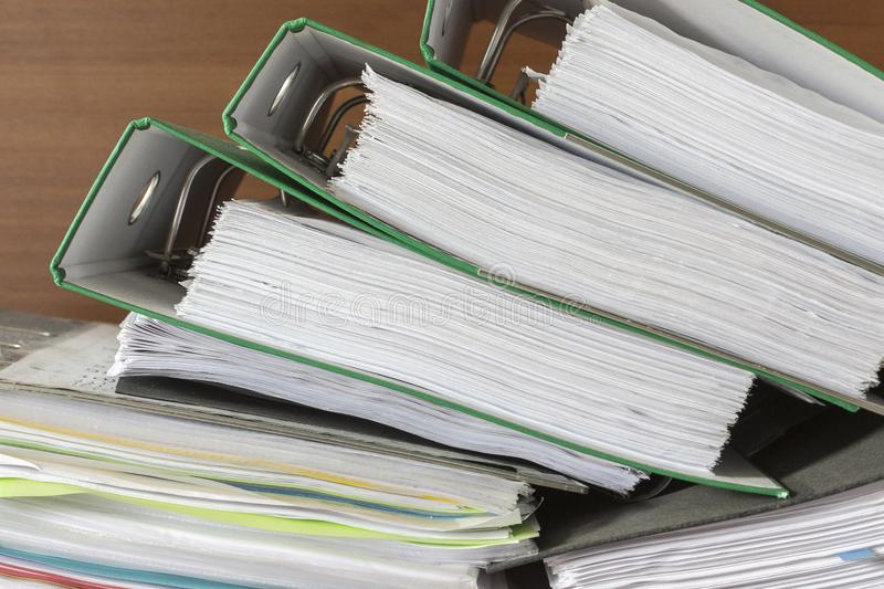 Folders of documents are stacked. Thick folders of documents are stacked for background stock photo