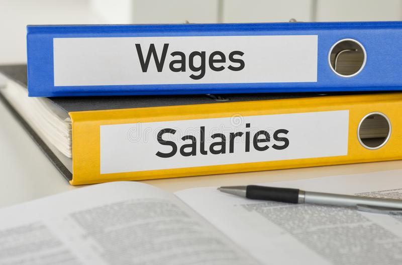 Folders with the label Wages and Salaries. Two folders with the label Wages and Salaries stock images