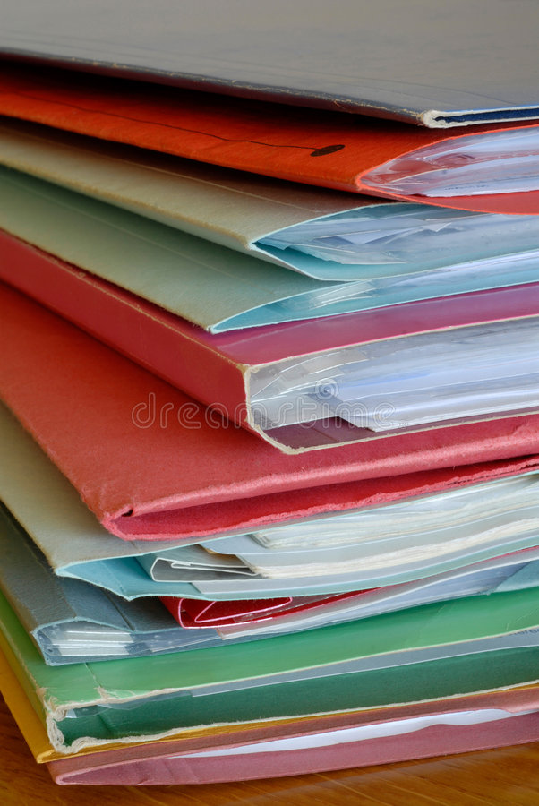 Folders V. A stack of folders & papers on a desk in the office royalty free stock images