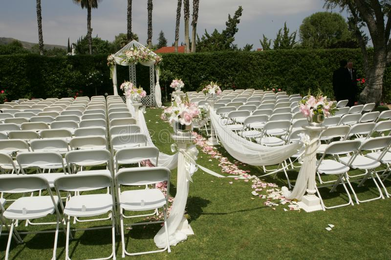 Outdoor wedding white chairs , bridal party royalty free stock photos