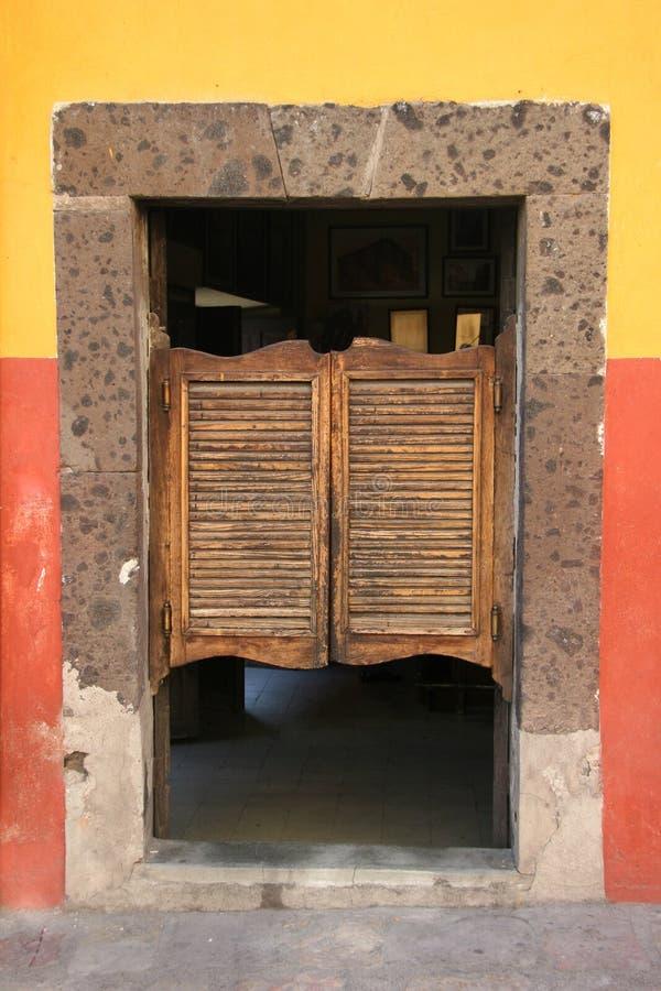 Folding door in old saloon stock images