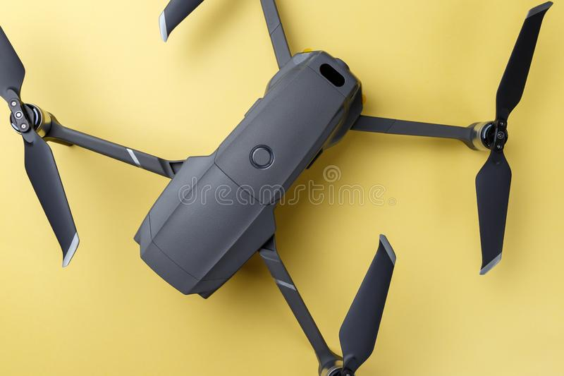 Folding drone. Drone equipment on yellow background. Trendy colorful photo. Minimal style. Top view. Flat lay stock images