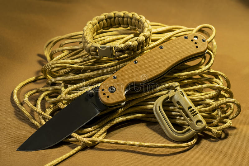 Folding knife on paracord royalty free stock photography