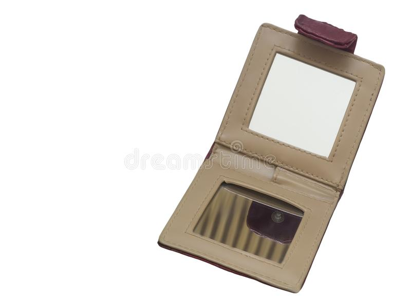 A small folding mirror on a white background. Folding mirror compact for women on a leather cover. Presented on a white background stock photos