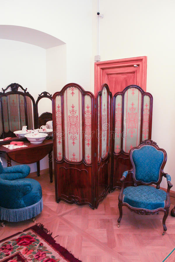 Folding screen in the corner. stock images