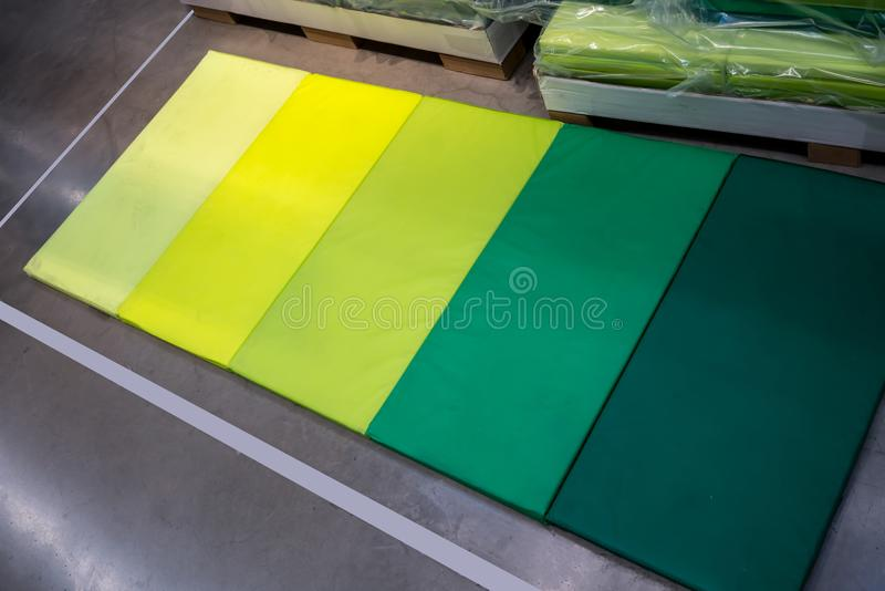 Folding soft mat in green tones for multi purposes. Sport fitness mattress and kid crawling mat royalty free stock image
