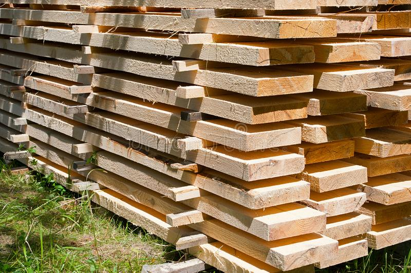 Folding wooden boards on the ground. Raw material construction royalty free stock image
