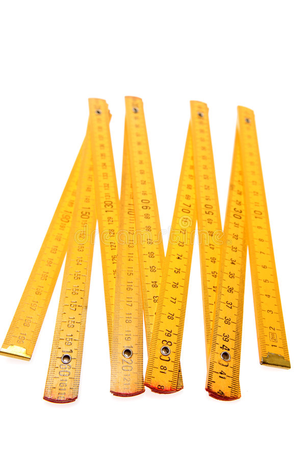 Folding Yellow Ruler. A yellow folding ruler, isolated on a white background royalty free stock image