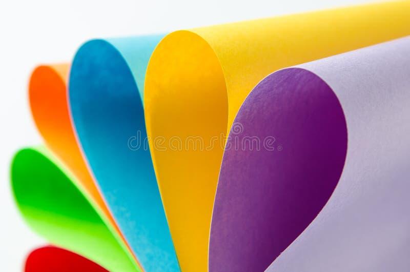Folhas coloridas do papel da cor, fundo abstrato imagem de stock