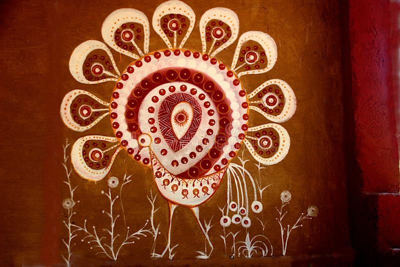 Folk Art at Madhuvana, Bengaluru. Beautiful peacock painted with white dye on brown colored wall at Madhuvana village park near Bengaluru in Karnataka, India royalty free stock photography