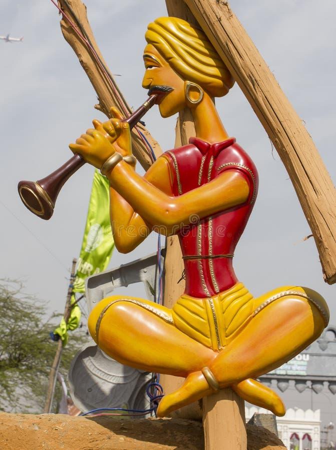 Folk artist statue in surajkund fair royalty free stock photo